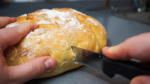 Pan cortado sin llegar a hacer rebanadas